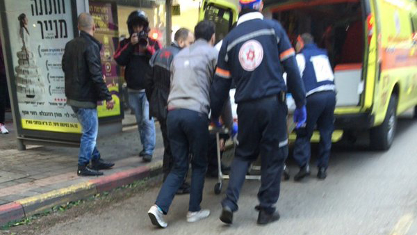Paramedics respond to an incident in Tel Aviv, Israel on Friday, Jan. 1, 2016.