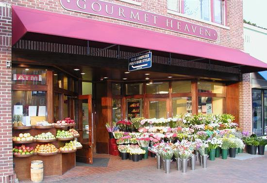 The owner of popular New Haven restaurant Gourmet Heaven has been charged with more than 50 counts of labor law violations, and an employee says he hopes the arrest will eventually bring him the $20,000 he's owed.