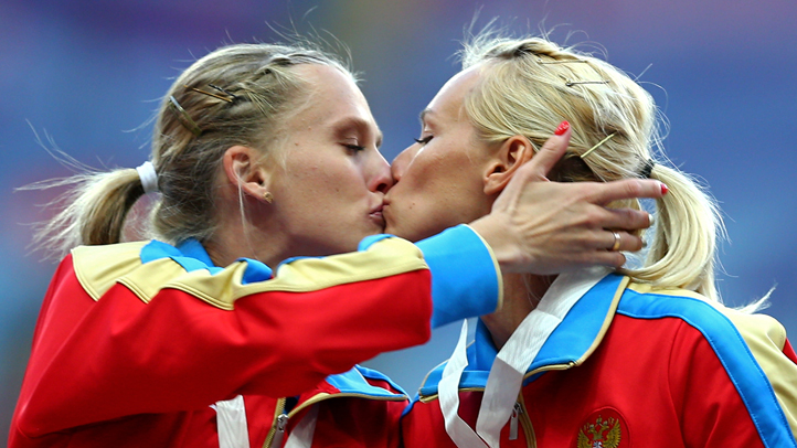 Gold medalist Tatyana Firova (L) and Kseniya Ryzhova of Russia kiss on the podium during the medal ceremony for the Women's 4x400 metres Relay during Day Eight of the 14th IAAF World Athletics Championships Moscow 2013 at Luzhniki Stadium on August 17, 2013 in Moscow, Russia.