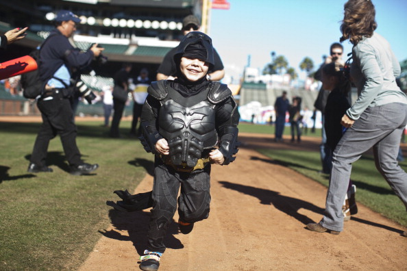 SAN FRANCISCO, CA - NOVEMBER 15: Leukemia survivor Miles, 5, dressed as BatKid, runs the bases as part of a Make-A-Wish foundation fulfillment at AT&T Park November 15, 2013 in San Francisco. The Make-A-Wish Greater Bay Area foundation turned the city into Gotham City for Miles by creating a day-long event bringing his wish to be BatKid to life. (Photo by Ramin Talaie/Getty Images)