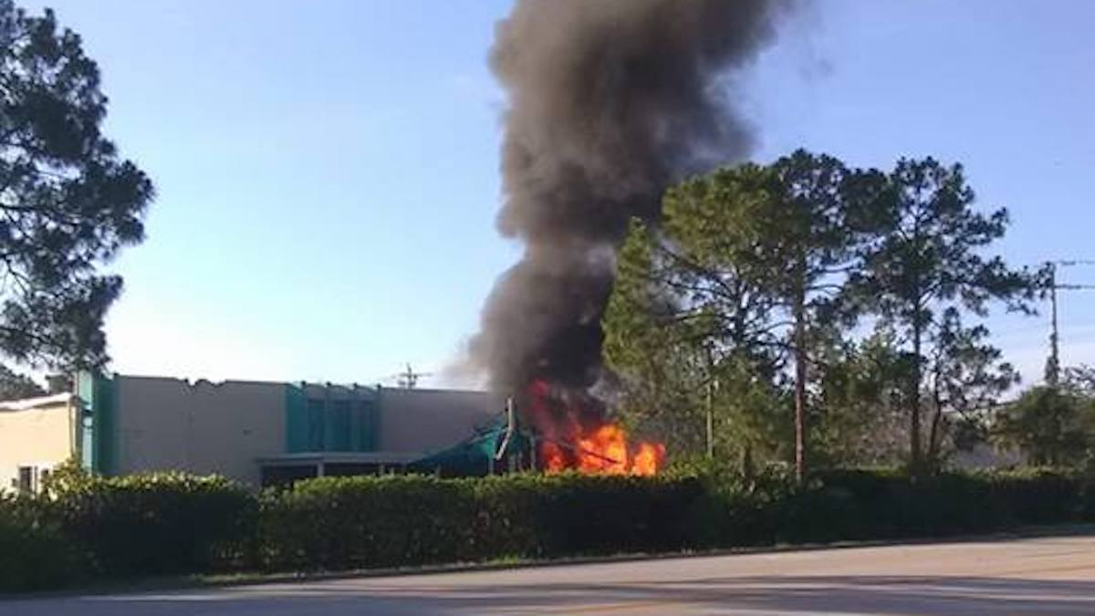 A view of the plane crashing into a Fort Myers day care building after a failed takeoff. One of the passengers on the plane died and the other was injured. No one was inside the day care building.