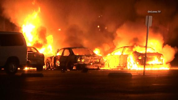 Four cars were set on fire at a government center parking lot in Ventura early Saturday, Feb. 21, 2015.