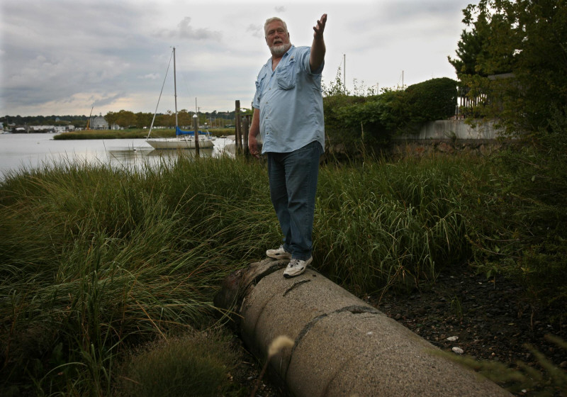 Soundkeeper Terry Backer stands on an outflow pipe that drains storm water from the Norwalk streets on Wednesday, September 16, 2009. Backer began a pilot program installing filters in the storm drain system to prevents oil, chemicals, heavy metals, and bacteria from washing into the Sound.