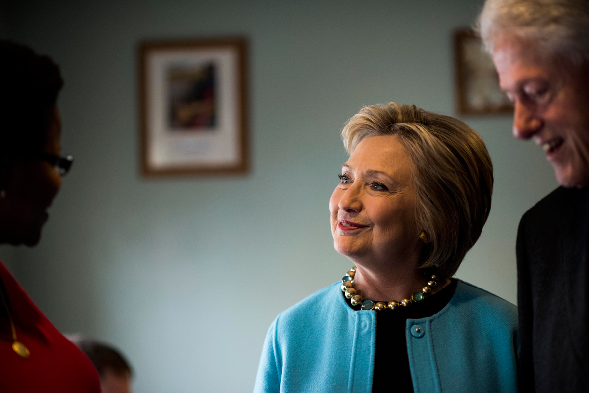 Former Secretary of State Hillary Clinton visits with voters and eat breakfast at Chizvachon Restaurant a day before the New Hampshire primary in Manchester, New Hampshire on Monday, February 8, 2016.