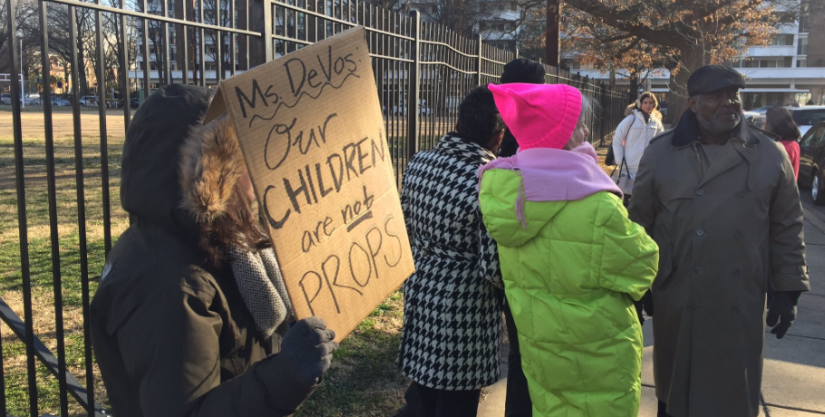 Protesters outside Washington, D.C.'s Jefferson Middle School Academy, where Secretary of Education Betsy DeVos was making a visit, on Friday, Feb. 10, 2017