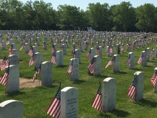 Hundreds of Volunteers Place Flags on Graves at Veterans Cemetery