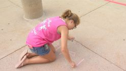 Young Girl Using Chalk Walk to Uplift Patients