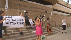 Protesters Stage Demonstration Against Chief Esserman Outside NHPD