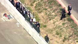RAW VIDEO: Trump Jumps Wall to Get Past Protesters