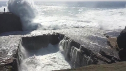 WATCH: Giant Wave Sweeps Woman Off Cliff