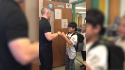 Colorado Teacher Has Custom Handshake for Each Student