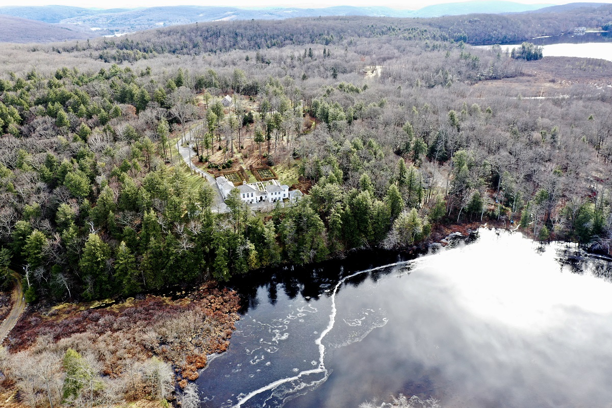 The property, which is listed for $5.9 million, includes more than 14 acres and shared boundaries with the Weantinogue Land Trust.