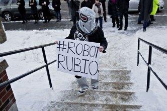 Scenes From N.H.: Sanders Shoots Hoops, 'Robot' Tails Rubio