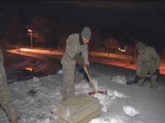 National Guard Helps Tolland Clear School Roofs