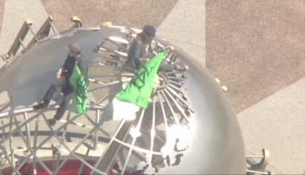 Calif. Earth Day Protesters Scale Universal Studios Globe