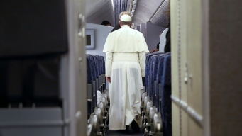 Pope Talks of Abuse & U.S. Trip en Route Home
