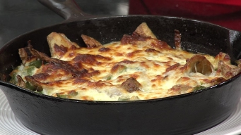Skillet of Potato Skins with Jalapeno, White Onion and Cheddar