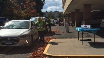 Hundreds of People Line Up for Drive-Thru Flu Shot Clinic in Farmington