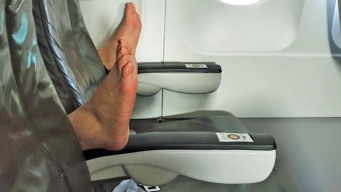 Feet Jabbed Into Empty Row Make for In-Flight 'Nightmare'