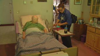 Nurses Assess Elderly As Heat Rises