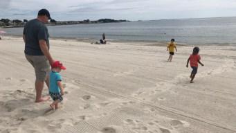 People on the Shoreline Soak Up Last Bit of Summer