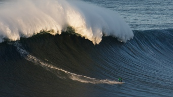 Surfer Breaks Back in Massive 50-Foot Wave Wipeout