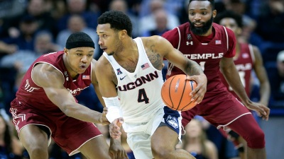 Adams Scores 25 to Lead UConn Over Temple
