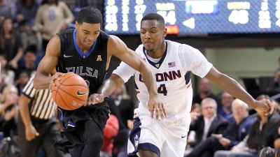 Woodard, Tulsa Come From Behind to Take Down UConn 60-51