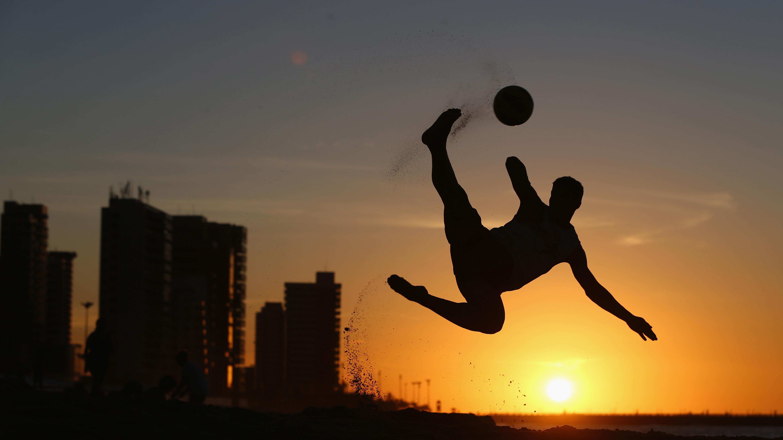 A local boy shows off his beach football skills on Magna Praia beach on June 11, 2014 in Fortaleza, Brazil.