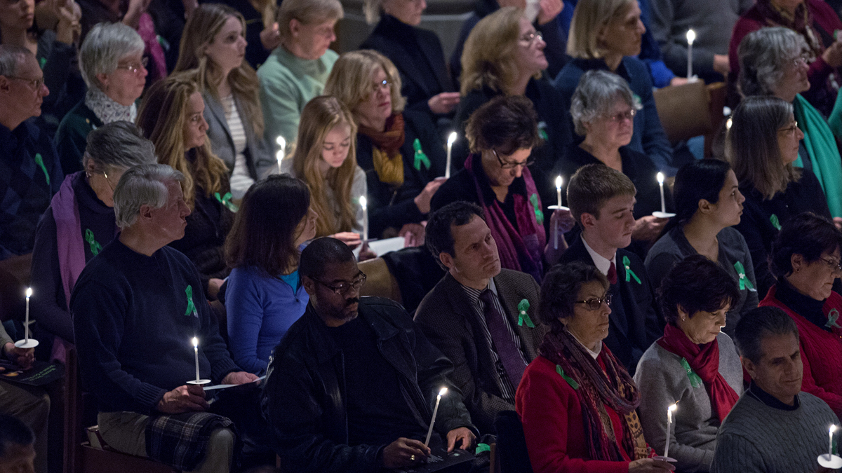 People hold candles during The National Vigil for Victims of Gun Violence on December 12, 2013 at the National Cathedral in Washington, DC.