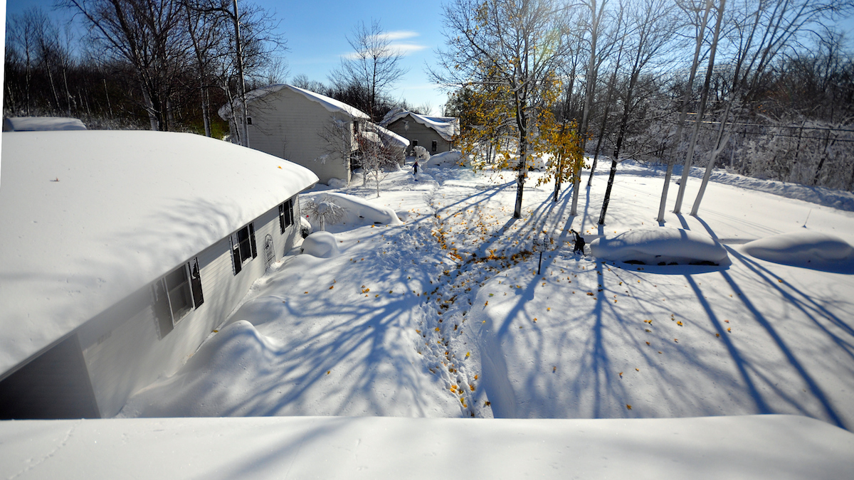 Drew Ahmed makes his way through nearly five feet of snow in Lakeview, New York November 19, 2014.