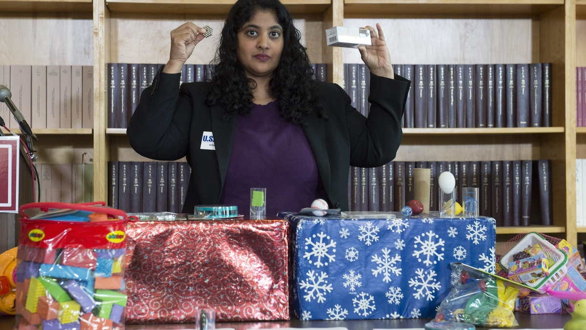 Sujatha Jahagirdar, Public Health Campaign Director at the US Public Interest Research Group, holds up examples of unsafe toys during a press conference at USPIRG as they release the 29th annual Trouble in Toyland report about dangerous or toxic toys, in Washington, DC, December 1, 2014.