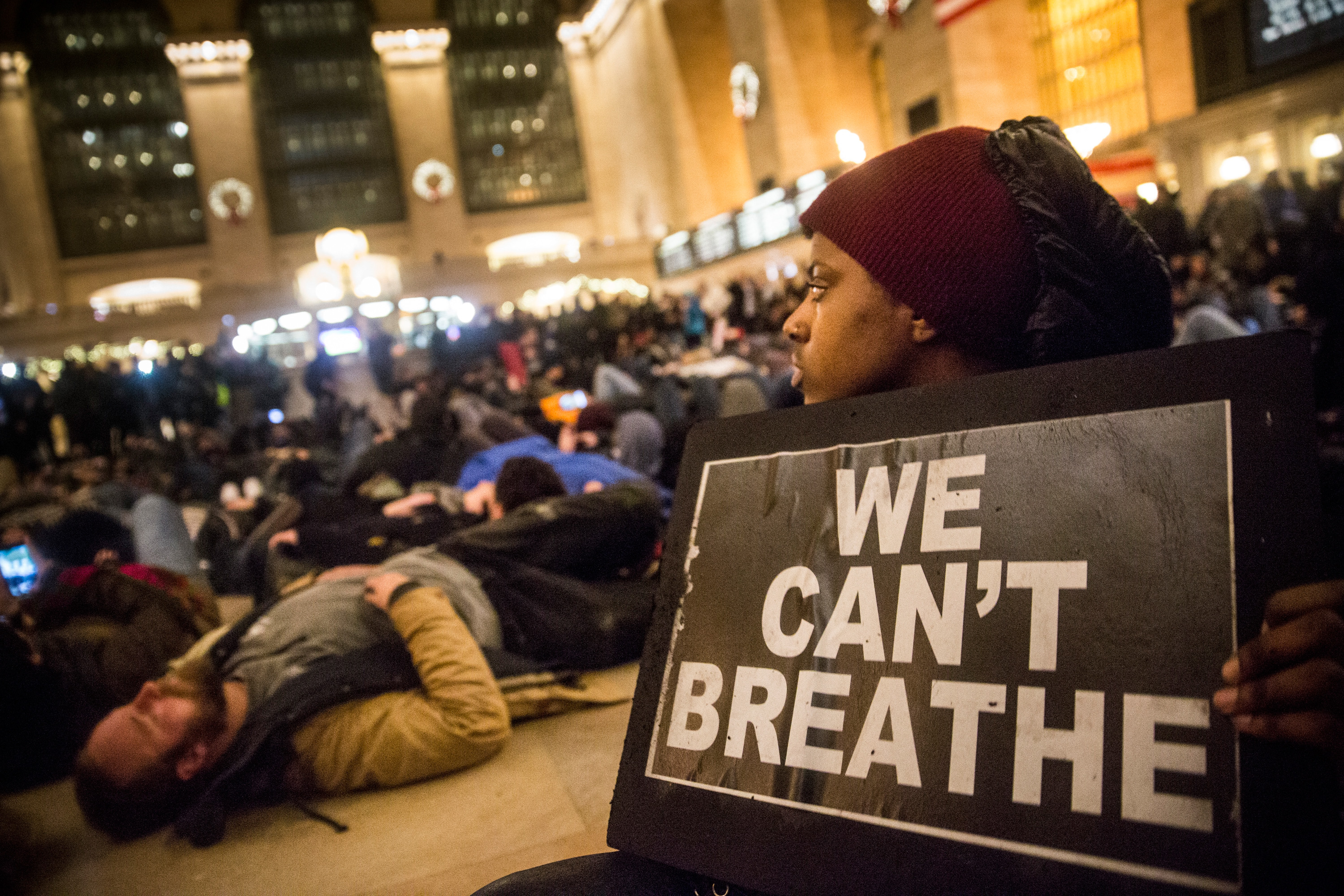 Demonstrators hold a die-in in Grand Central Terminal protesting the Staten Island, New York grand jury's decision not to indict a police officer involved in the chokehold death of Eric Garner in July on December 5, 2014 in New York City. The grand jury declined to indict New York City Police Officer Daniel Pantaleo in Garner's death. (Photo by Andrew Burton/Getty Images)