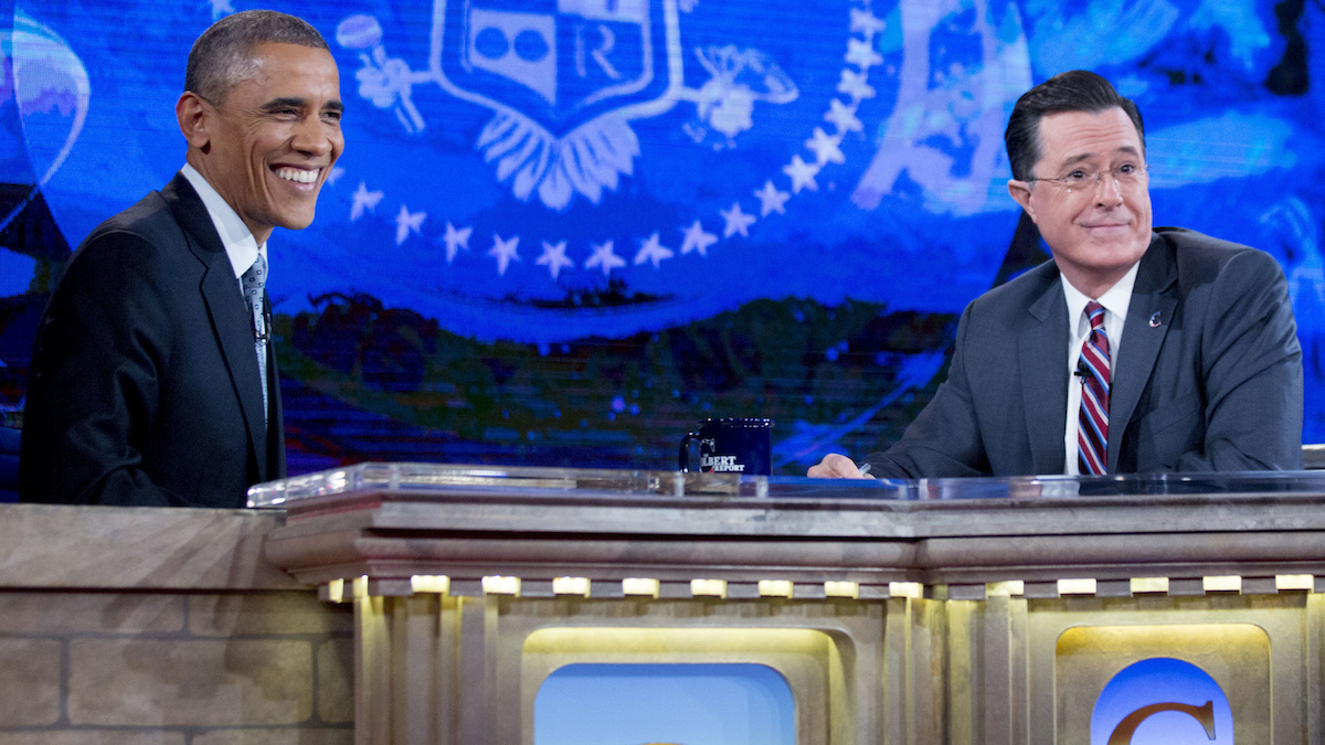 U.S. President Barack Obama, left, speaks with television personality Stephen Colbert during a taping of Comedy Central's