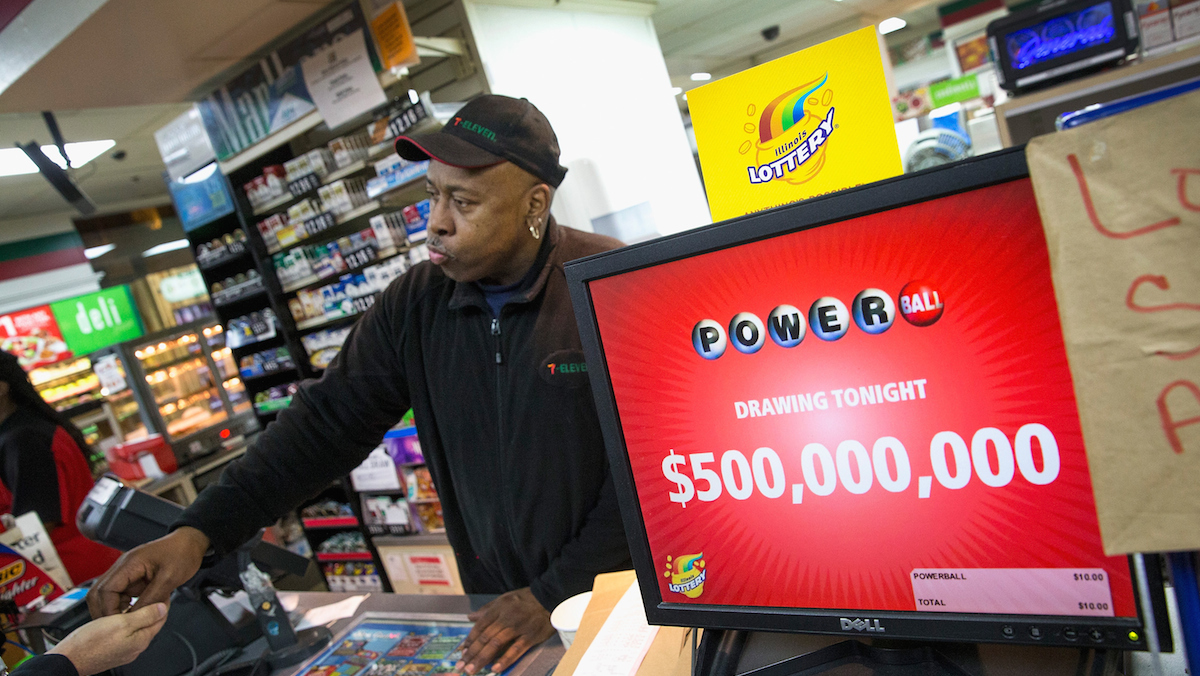 Kirk Cook rings up a Powerball lottery ticket sale at a 7-Eleven store on February 11, 2015 in Chicago, Illinois. Ticket sales have caused the jackpot to surge past $500 million, one of the largest in the game's history.