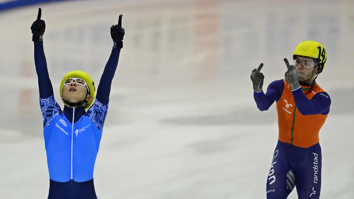 Sjinkie Knegt (R) of the Netherlands' team gestures next to Victor An (L) of the team of Russia celebrating after Russia won the men's 5000m relay final race of the ISU European Short Track speed skating Championships in Dresden, eastern Germany, on January 19, 2014. Russia won the race ahead of the Netherlands (2nd) and Germany.