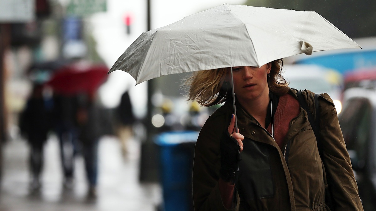SAN FRANCISCO, CA - FEBRUARY 06:  A pedestrian carries an umbrella while walking along Columbus Street on February 6, 2014 in San Francisco, California. The San Francisco Bay Area is getting much needed rain with up to a half inch of rain falling overnight and a bigger weather system expected to bring more precipitation over the weekend.  (Photo by Justin Sullivan/Getty Images)