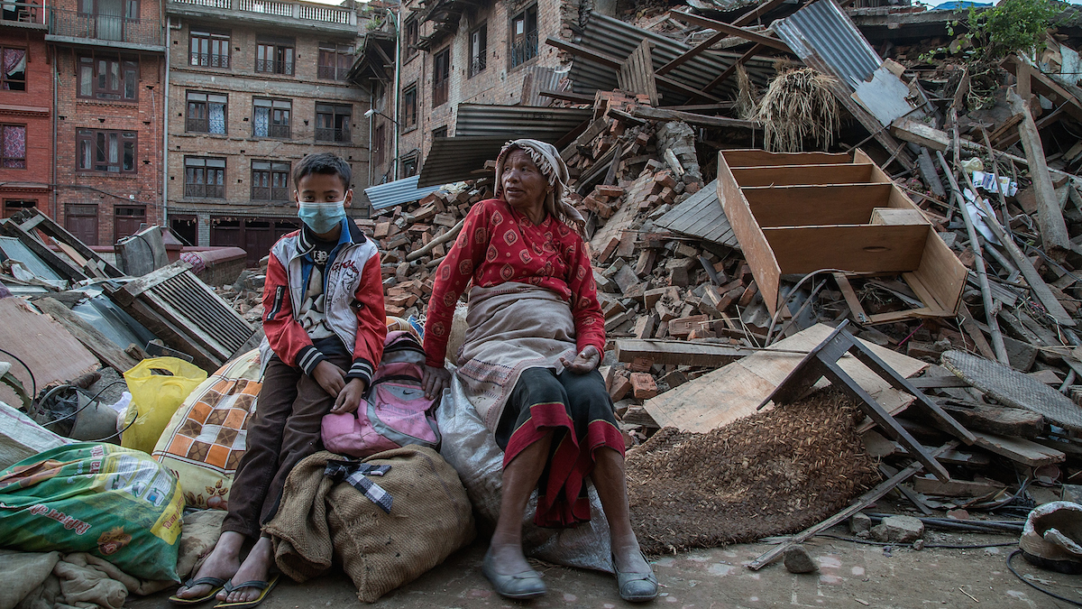 A 7.4-magnitude earthquake shook Nepal on Tuesday, May 12, as the country continues recovery operations just weeks after a 7.8 magnitude quake killed an estimated 8,000 people. Here, a grandmother and her grandson sit on the belongings that they have salvaged from their collapsed homes on April 29, 2015 in Bhaktapur, Nepal.