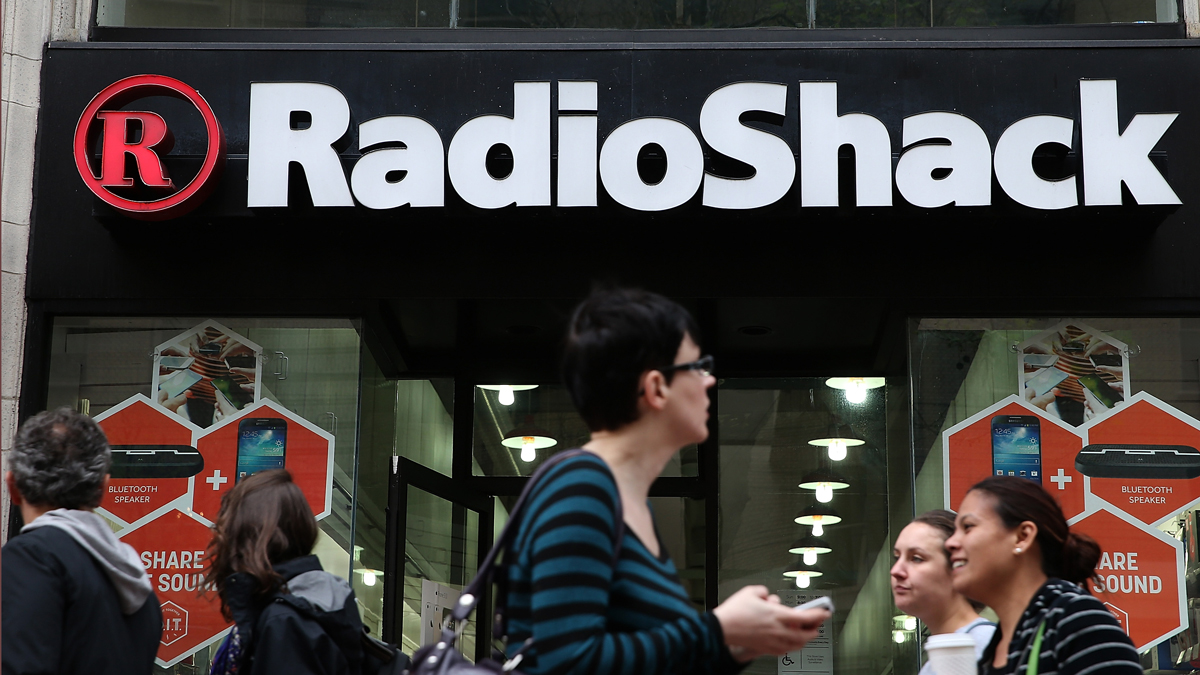 People walk by a Radio Shack store.