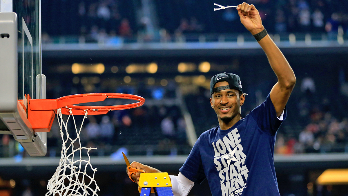 ARLINGTON, TX - APRIL 07:  DeAndre Daniels #2 of the Connecticut Huskies cuts the net after defeating the Kentucky Wildcats 60-54 in the NCAA Men's Final Four Championship at AT&T Stadium on April 7, 2014 in Arlington, Texas.  (Photo by Jamie Squire/Getty Images)