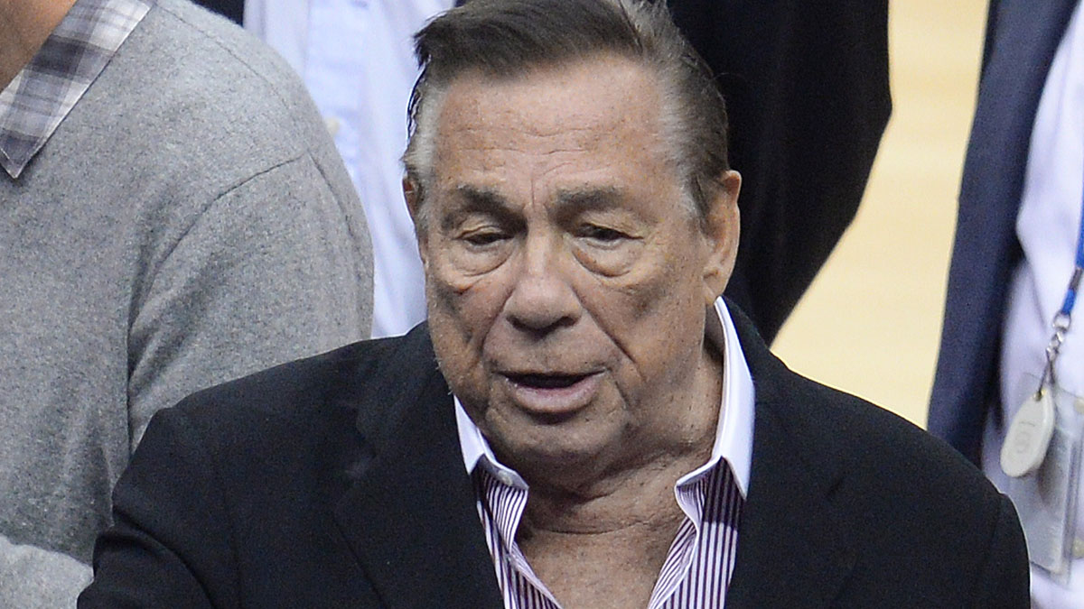 Los Angeles Clippers owner Donald Sterling attends the NBA playoff game between the Clippers and the Golden State Warriors, April 21, 2014 at Staples Center in Los Angeles, California.  NBA Commissioner Adam Silver said April 26 that the NBA is investigating Sterling for alleged racist comments.