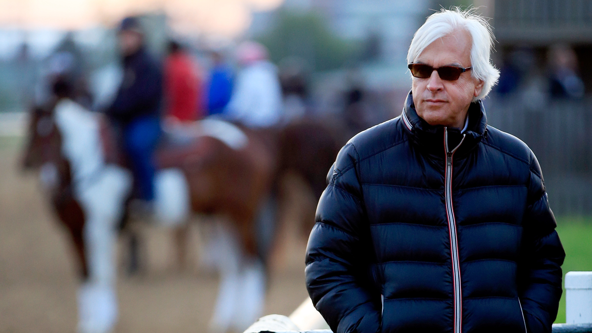 Bob Baffert, trainer of Kentucky Derby contenders Hoppertunity and Chitu, watches track activity during early morning workouts at Churchill Downs on May 1, 2014 in Louisville, Kentucky.
