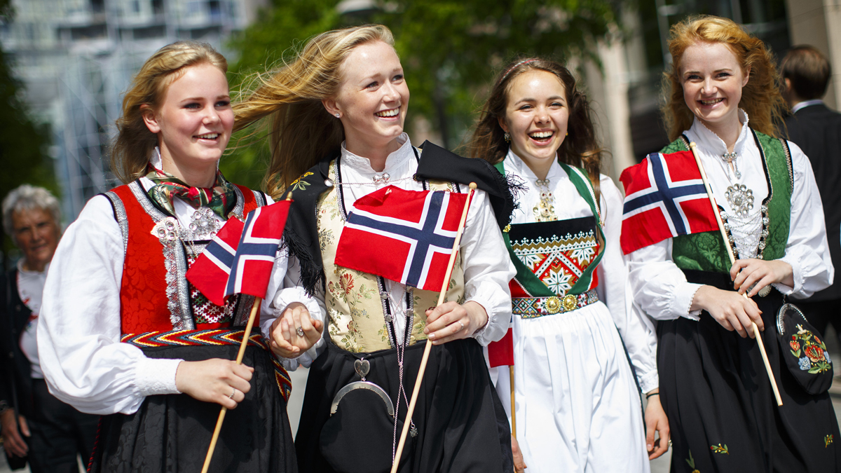 A group of girls with traditional dresses parading to celebrate Norwegian Constitution Day on May 17, 2014, in Oslo, Norway. Norway's Constitution, declaring the country to be an independent nation, was signed at Eidsvoll on 17 May, 1814. (Photo by Tolga Akmen/Anadolu Agency/Getty Images)