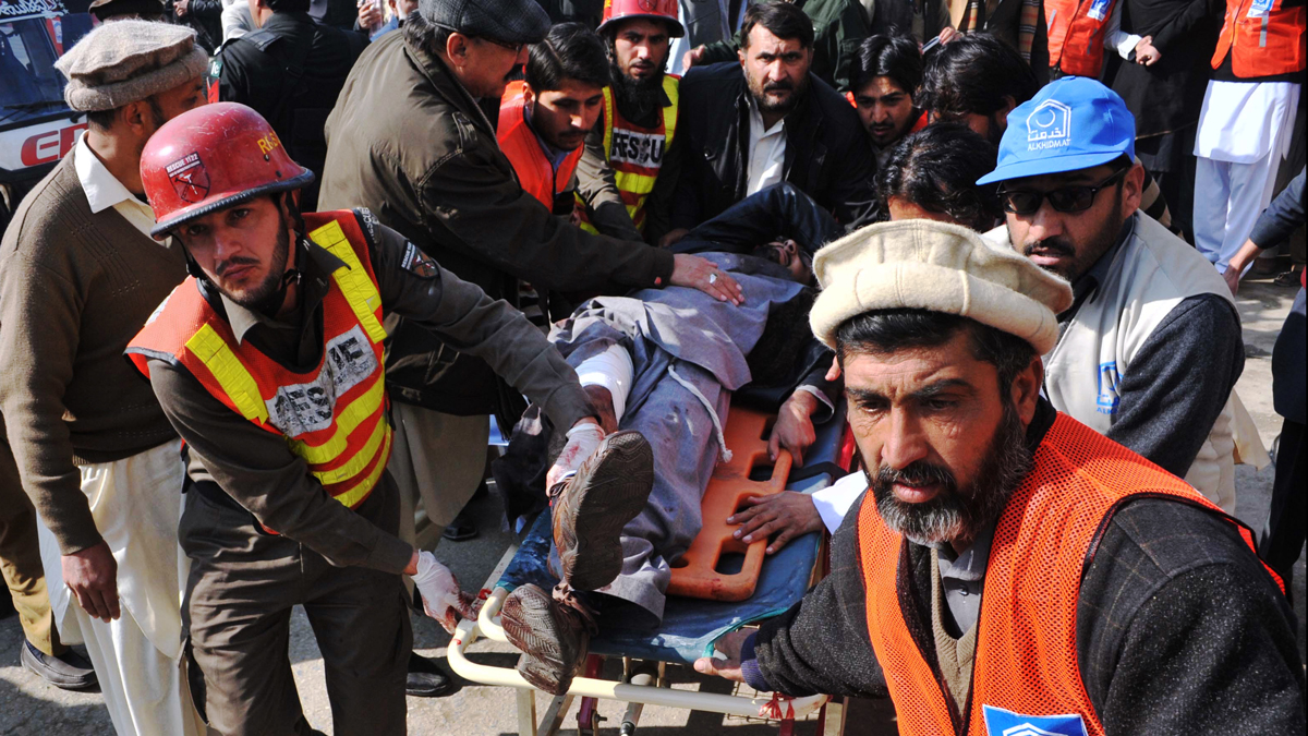 Pakistani rescuers shift an injured man to a hospital following an attack by gunmen in the Bacha Khan university in Charsadda, January 20, 2016.