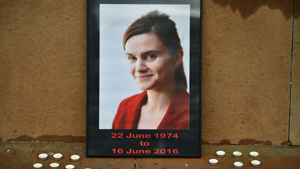 Candles surround a photo of Labour MP Jo Cox before a vigil in her memory in George Square on June 17, 2016, in Glasgow, Scotland. The Labour MP for Batley and Spen was about to hold her weekly constituency surgery in Birstall Library yesterday when she was shot and stabbed in the street on June 16. A 52-year old man was charged with murder in her death.