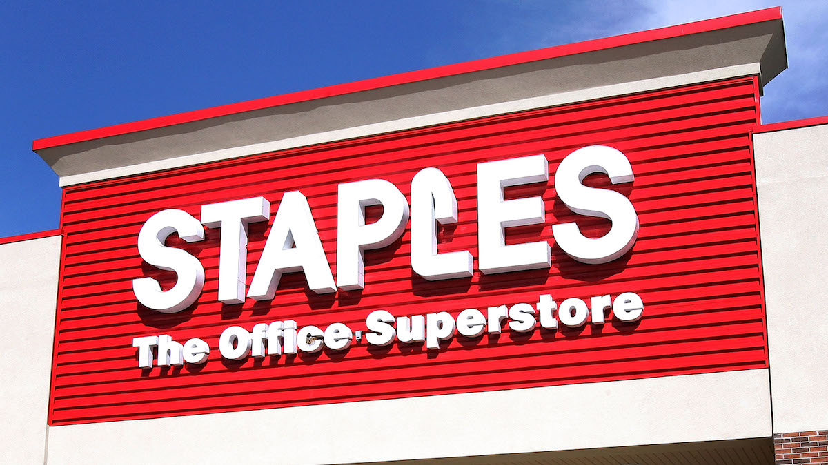File - A Staples sign on September 29, 2005 in Mount Prospect, Illinois. The office-supply store announced it would close 70 store in 2017 after reporting a loss in earning during the fourth quarter of fiscal year 2016.