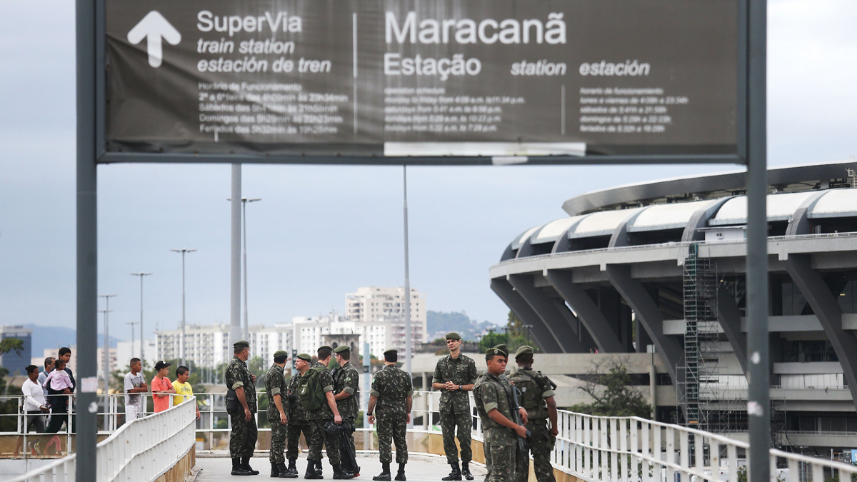 In this July 17, 2016, file photo, Brazilian soldiers stand on patrol during a security rehearsal of the Rio 2016 Olympic Games opening ceremony at the Maracana stadium. A group's plot to attack a Rio reservoir was more serious than stated at the time of their arrest, a source told NBC News.