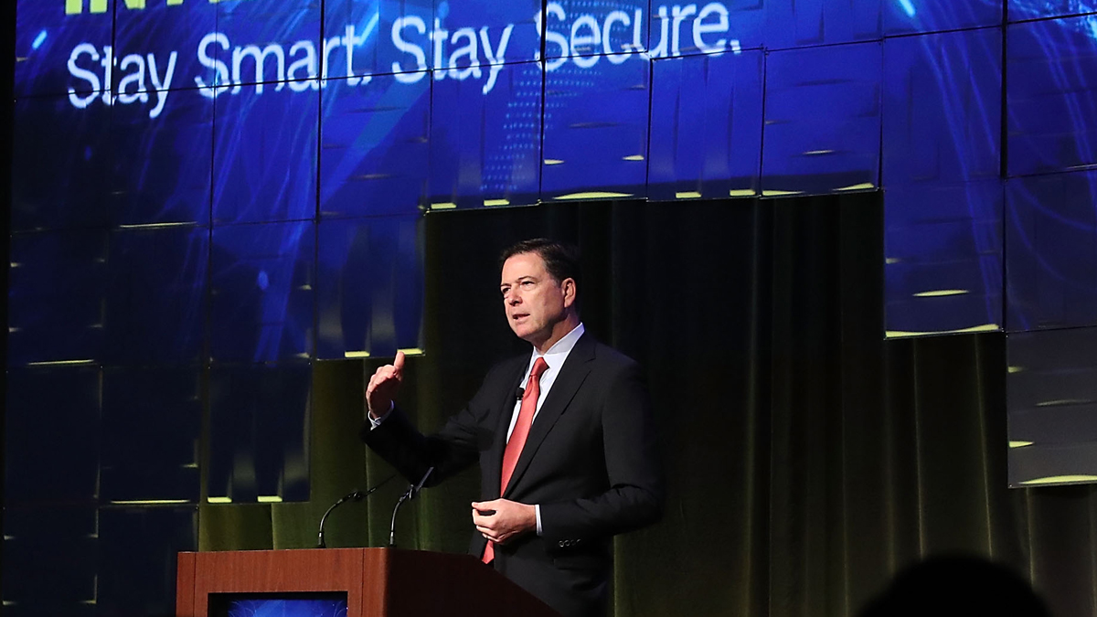 FILE - FBI Director James Comey speaks during a government symposium on cyber security, on Tuesday, August 30, 2016, in Washington, D.C.