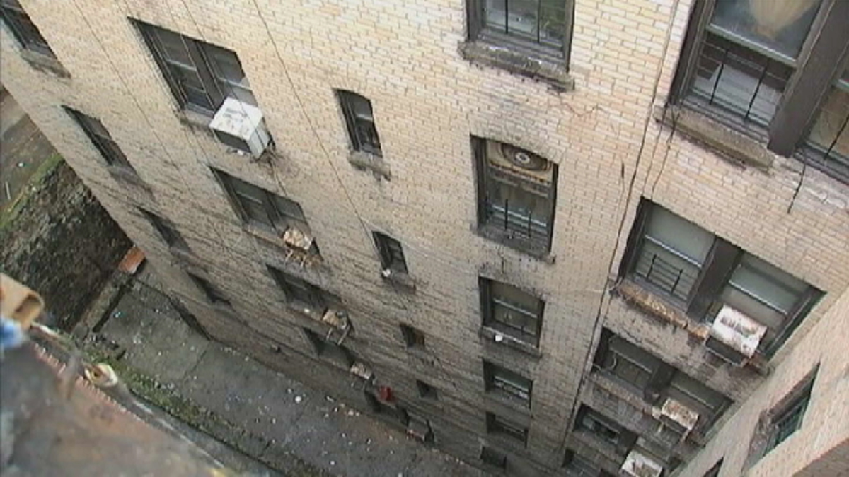 The teen fell six stories from this Bronx apartment building into the alley below.