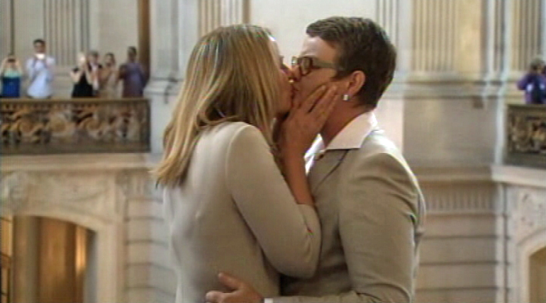 Proposition 8 plaintiffs Kris Perry and Sandy Stier become the first same-sex couple to be married in California after Prop 8 was overturned.
